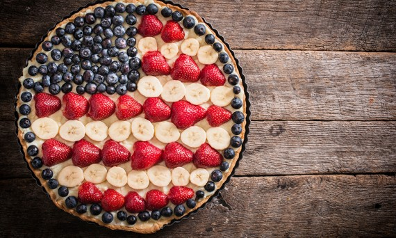 Sweet fruit and vanila pie with USA flag on the top,selective focus and blank space